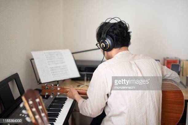 singer-songwriter composing new song - songwriter stock pictures, royalty-free photos & images