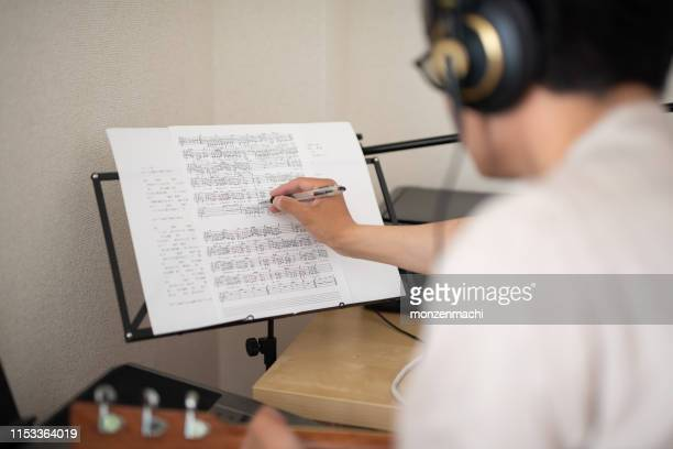 singer-songwriter composing new song - musical equipment stock pictures, royalty-free photos & images