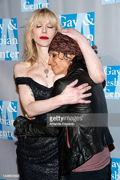 Singersongwriter Courtney Love and musician Linda Perry arrive at the LA Gay Lesbian Center's An Evening With Women at The Beverly Hilton Hotel on...