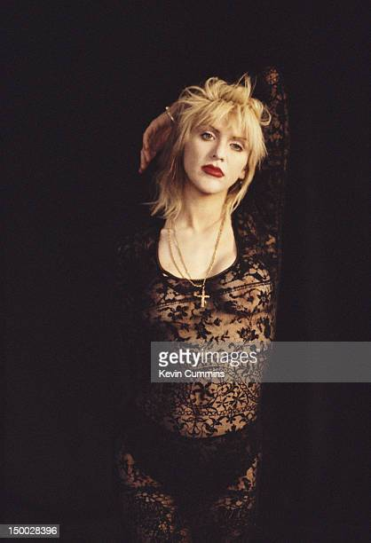 Singersongwriter Courtney Love of American alternative rock group Hole posing in a lace bodysuit 1995