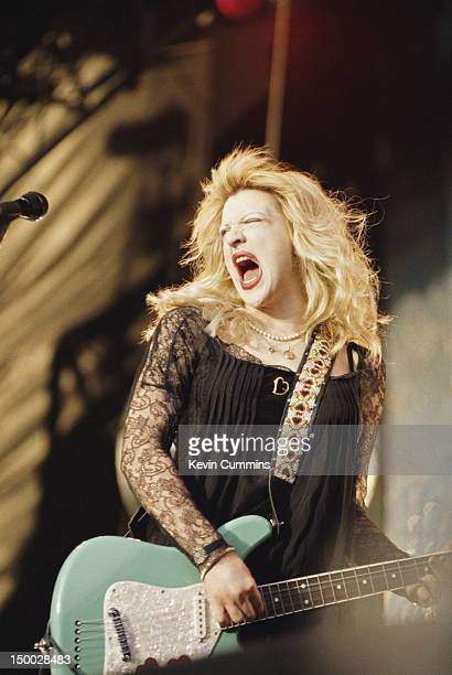 Singer-songwriter Courtney Love performing on stage with American alternative rock group Hole, Reading Festival, United Kingdom, 25th August 1995.