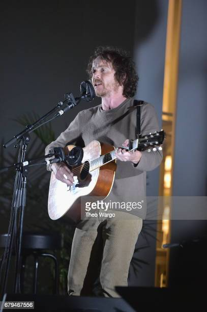 Singersongwriter Damien Rice performs onstage during Sean Penn Friends HAITI TAKES ROOT A Benefit Dinner Auction to Reforest Rebuild Haiti to Support...
