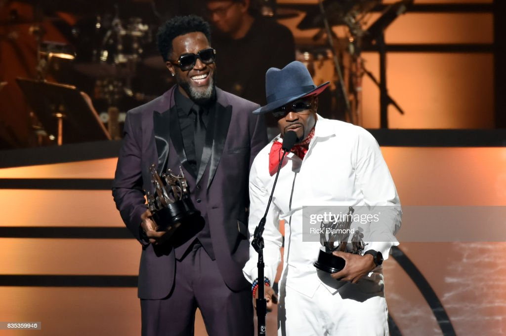 Singer-songwriter Damion Hall (L) and Teddy Riley (R) of Guy accept an award onstage at the 2017 Black Music Honors at Tennessee Performing Arts Center on August 18, 2017 in Nashville, Tennessee.