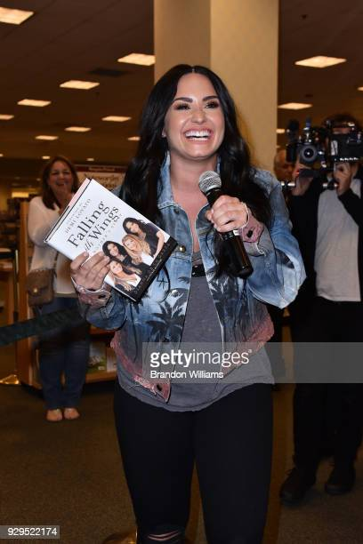 Singersongwriter Demi Lovato attends her mother author Dianna De La Garza's book signing of Falling with Wings at Barnes Noble at The Grove on March...