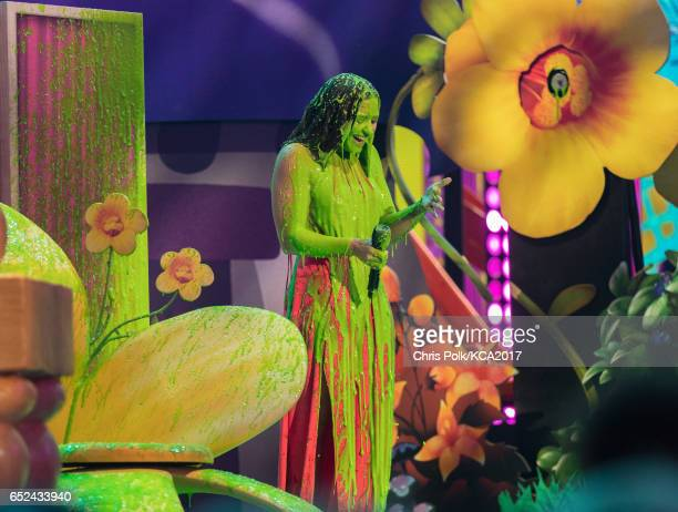 Singersongwriter Demi Lovato gets slimed onstage at Nickelodeon's 2017 Kids' Choice Awards at USC Galen Center on March 11 2017 in Los Angeles...