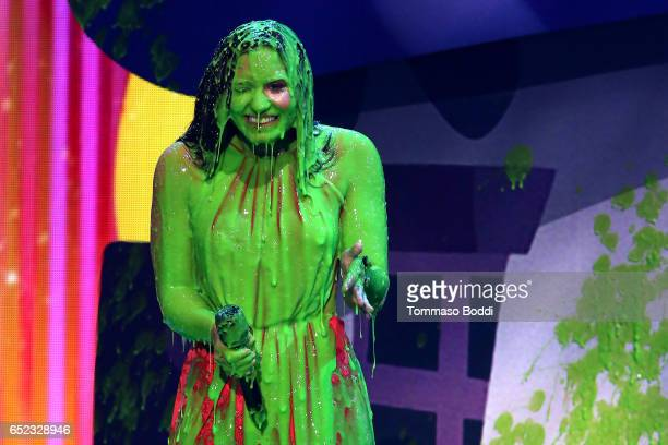 Singersongwriter Demi Lovato gets slimed onstage at the Nickelodeon's 2017 Kids' Choice Awards at USC Galen Center on March 11 2017 in Los Angeles...