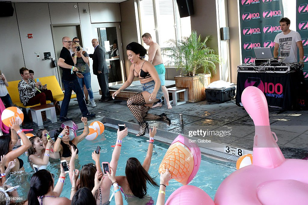 Singer-songwriter Demi Lovato jumps into the pool during Demi Lovato's Debut of her New Single, 'Cool for the Summer,' with Z100 at Gansevoort Park Avenue on July 1, 2015 in New York City.