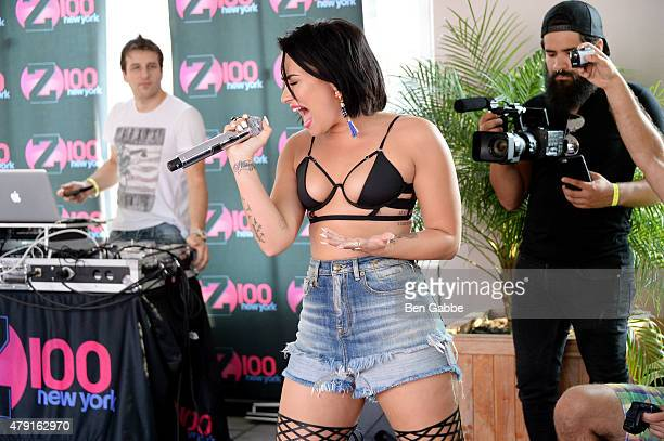 Singersongwriter Demi Lovato performs during Demi Lovato's Debut of her New Single 'Cool for the Summer' with Z100 at Gansevoort Park Avenue on July...