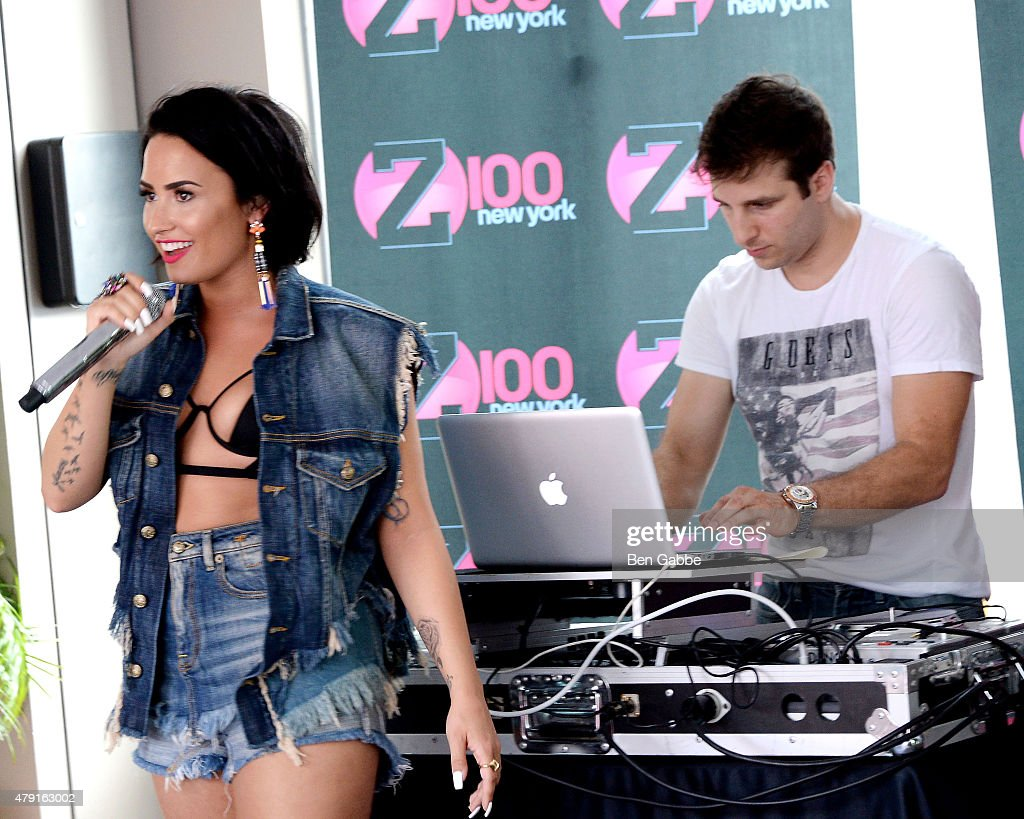 Singer-songwriter Demi Lovato performs during Demi Lovato's Debut of her New Single, 'Cool for the Summer,' with Z100 at Gansevoort Park Avenue on July 1, 2015 in New York City.