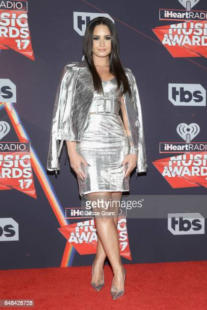 Singersongwriter Demi Lovato poses in the press room at the 2017 iHeartRadio Music Awards which broadcast live on Turner's TBS TNT and truTV at The...