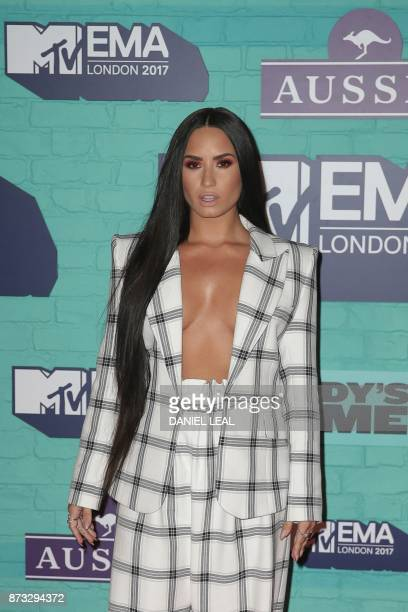 US singersongwriter Demi Lovato poses on the red carpet arriving to attend the 2017 MTV Europe Music Awards at Wembley Arena in London on November 12...