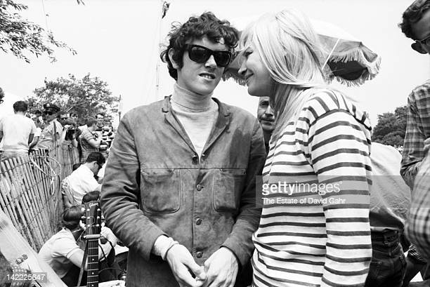 Singer/songwriter Donovan making his US debut and singer Mary Travers of Peter Paul and Mary backstage at the Newport Folk Festival in July 1965 in...
