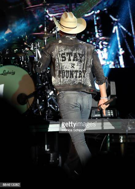 Singersongwriter Dustin Lynch is seen wearing a denim jacket from the 'Stay Country' clothing line designed by Dustin Lynch while he performs on...