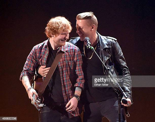 Singer/songwriter Ed Sheeran and rapper Macklemore perform onstage during the 2014 iHeartRadio Music Festival at the MGM Grand Garden Arena on...