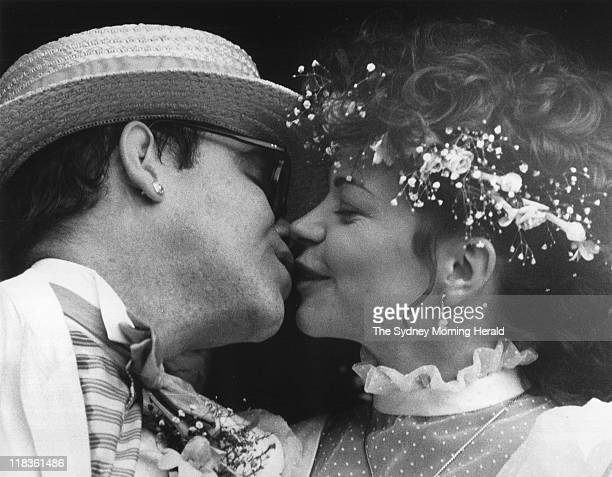 Singersongwriter Elton John and German music engineer Renate Blauel kiss after the couple were married at St Marks Church Darling Point 14 February...