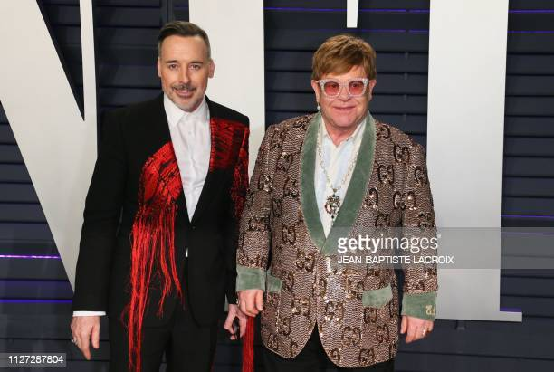 Singer/songwriter Elton John and husband filmmaker David Furnish attends the 2019 Vanity Fair Oscar Party following the 91st Academy Awards at The...