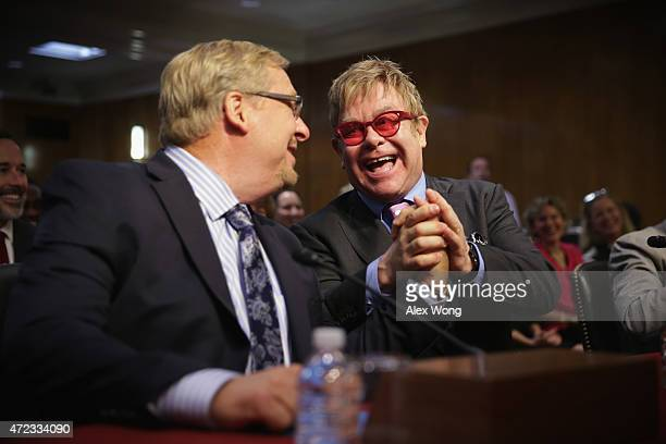 Singer/songwriter Elton John and pastor of the Saddleback Church Rick Warren shake hands prior to a hearing before the State, Foreign Operations and...