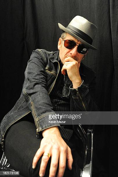 Singersongwriter Elvis Costello poses backstage at the 2013 Global Citizen Festival in Central Park to end extreme poverty on September 28 2013 in...