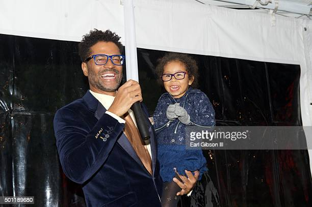 Singer/Songwriter Eric Benet and his daughter Lucia Bella share the microphone at the In A Perfect World 10 Year Celebration Of Giving on December 12...