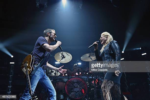 Singer/songwriter Eric Church and singer Joanna Cotton perform during the Outsiders World Tour at Madison Square Garden on October 17 2014 in New...