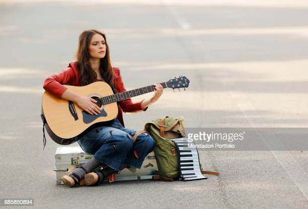 Singersongwriter Francesca Michielin playing guitar on the avenue leading to Palazzo Mondadori Segrate Italy 20th April 2016