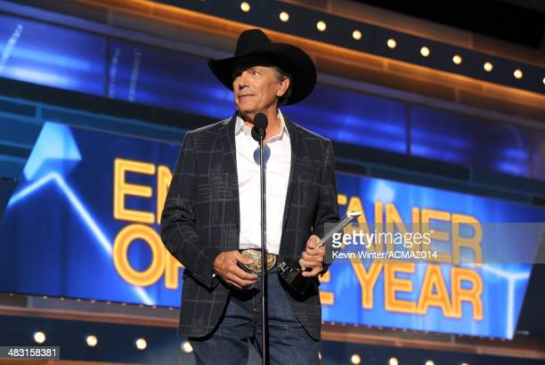 Singer/songwriter George Strait accepts the Entertainer of the Year award onstage during the 49th Annual Academy of Country Music Awards at the MGM...