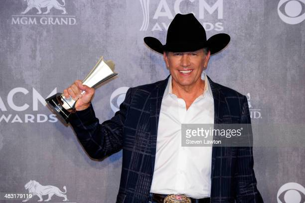 Singer/songwriter George Strait pose in the press room with the Entertainer of the Year award during the 49th Annual Academy Of Country Music Awards...