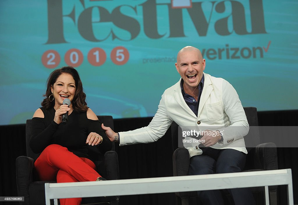 Singer-songwriter Gloria Estefan (L) and rapper Pitbull speak onstage during Festival PEOPLE En Espanol 2015 presented by Verizon at Jacob Javitz Center on October 18, 2015 in New York City.