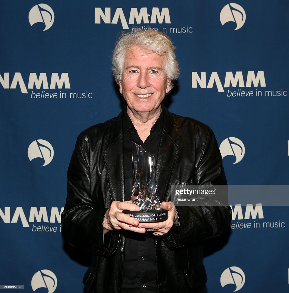 Singer-songwriter Graham Nash poses backstage with the 2016 Music for Life Award at the 2016 NAMM Show Opening Day at the Hilton Anaheim on January 21, 2016 in Anaheim, California.