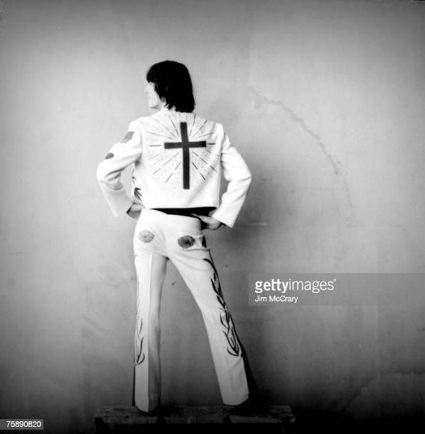 Singer/songwriter Gram Parsons poses for a portrait wearing his famous Nudie Suit designed by Nudie Cohn of Nudie's Rodeo Tailor's in 1969