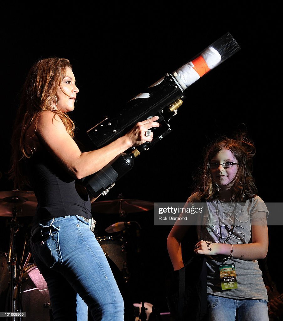 Singer/Songwriter Gretchen Wilson and Her Daughter Grace Wilson helps Mom during the 2010 BamaJam Music & Arts Festival at the corner of Hwy 167 and County Road 156 on June 5, 2010 in Enterprise, Alabama.