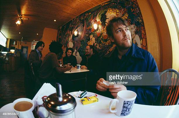 Singersongwriter Guy Garvey in a cafe with the other members of English alternative rock group Elbow December 2000 Left to right keyboard player...