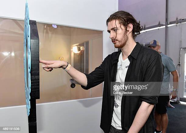 Singer/songwriter Hozier poses in the photobooth backstage at The Daytime Village during the 2015 iHeartRadio Music Festival at the Las Vegas Village...