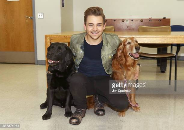 Singer/songwriter Hunter Hayes with two WCC service dogs attend the Heartgardians Campaign Launch at Manhattan VA Medical Center on April 11 2017 in...