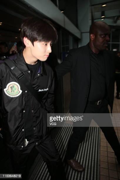 Singer/songwriter Hwang Minhyun of South Korean boy group Wanna One is seen at an airport on June 4 2019 in Hong Kong China