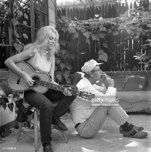Singer/songwriter Jackie DeShannon poses for a portrait session with photographer Earl Leaf with an acoustic guitar in circa 1967 in Los Angeles...