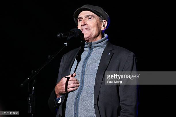 Singer/songwriter James Taylor performs during the 94th Annual National Christmas Tree Lighting Ceremony on the Ellipse in President's Park on...