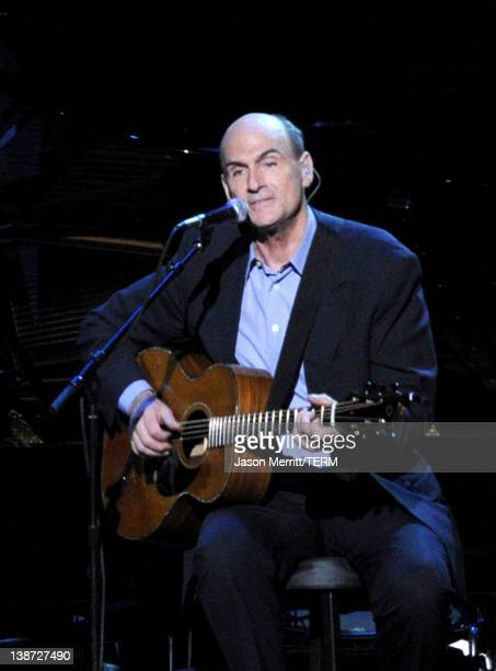 Singer/Songwriter James Taylor performs onstage at the 2012 MusiCares Person of the Year Tribute to Paul McCartney held at the Los Angeles Convention...