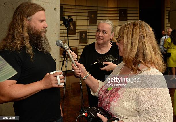Singer/Songwriter Jamey Johnson talks with some press during the 2014 Country Music Hall Of Fame Inductees Announcement at the Country Music Hall of...