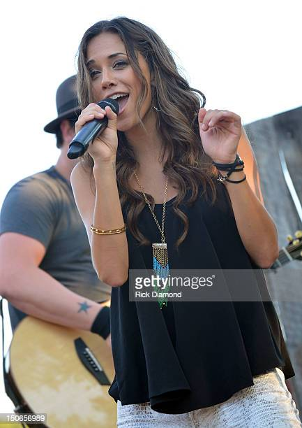 Singer/Songwriter Jana Kramer performs during Warner Music Nashville's Pickin' on the Patio on the patio at the Warner Brothers offices on August 23...