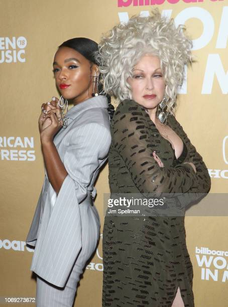 Singer/songwriter Janelle Monae and singer Cyndi Lauper attend the Billboard's 13th Annual Women in Music event at Pier 36 on December 6 2018 in New...