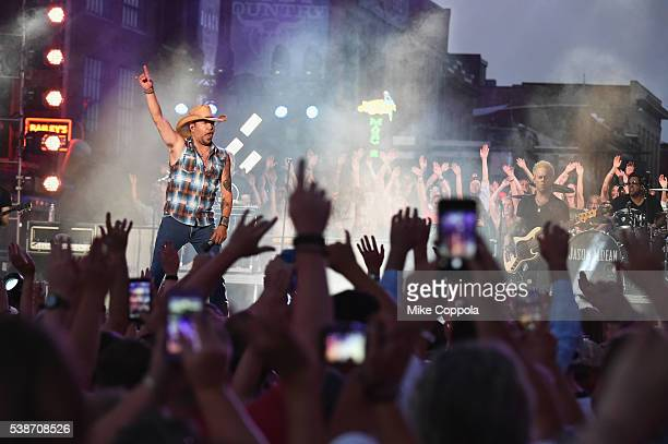 Singersongwriter Jason Aldean performs on stage during rehearsals at Bridgestone Arena on June 7 2016 in Nashville Tennessee