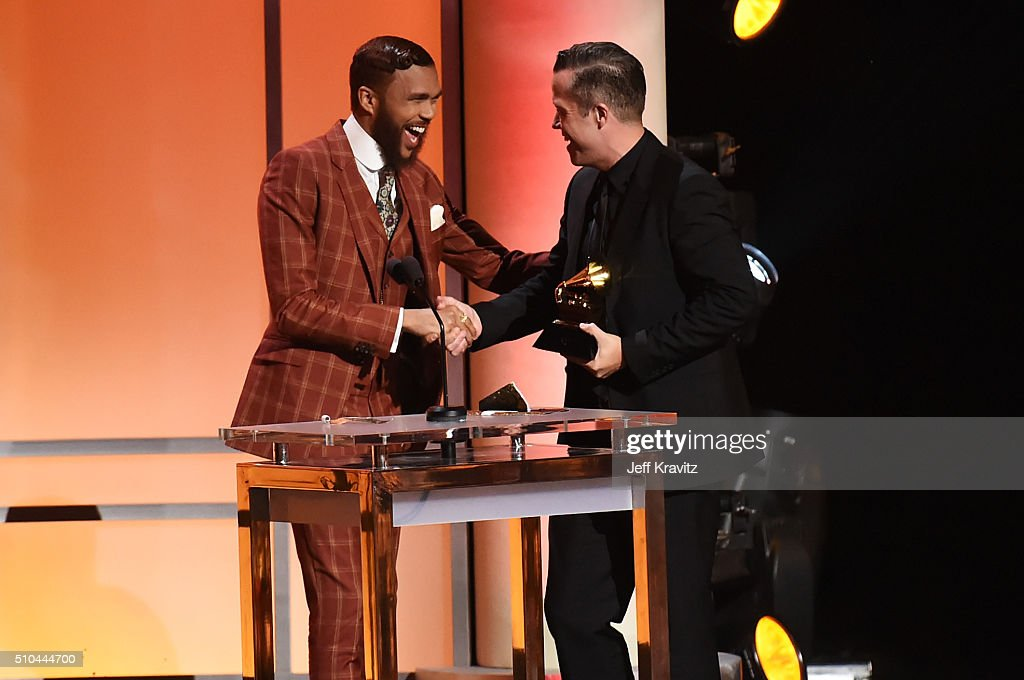 Singer/songwriter Jason Isbell (R) accepts the award for Best American Album for 'Something More Than Free' from singer/producer Jidenna onstage during The 58th GRAMMY Premiere Ceremony at Los Angeles Convention Center on February 15, 2016 in Los Angeles, California.
