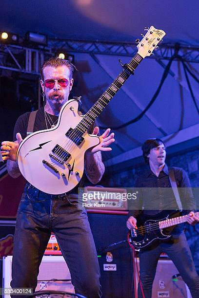 Singersongwriter Jesse Hughes and musician Matt McJunkins of the band Eagles of Death Metal perform in concert at Stubb's BarBQ on May 21 2016 in...