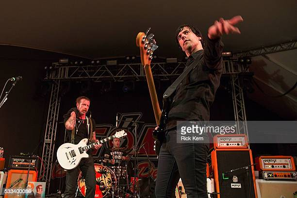 Singersongwriter Jesse Hughes drummer Jorma Vic and Matt McJunkins of the band Eagles of Death Metal performs in concert at Stubb's BarBQ on May 21...