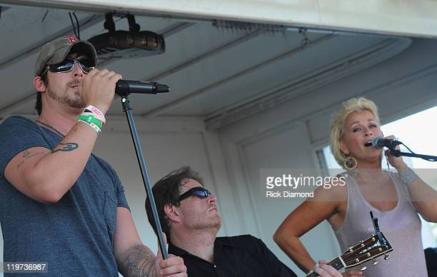Singer/Songwriter Jesse Keith Whitley is joind onstage by his mother Lorrie Morgan during Country Thunder music festival Day 3 on July 23 2011 in...
