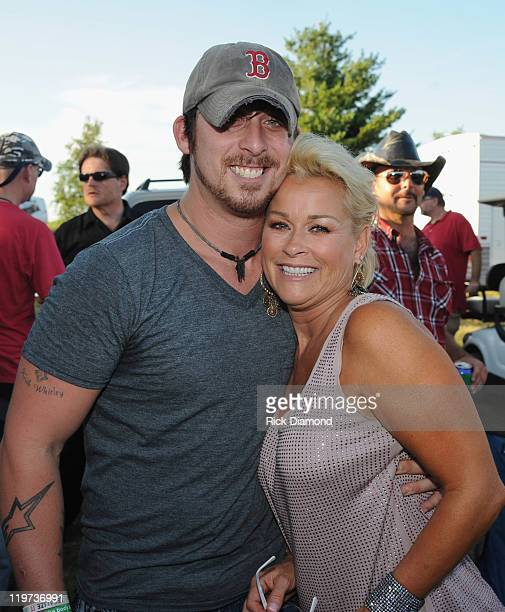 Singer/Songwriter Jesse Keith Whitley is joined backstage by his mother Lorrie Morgan during Country Thunder music festival Day 3 on July 23 2011 in...