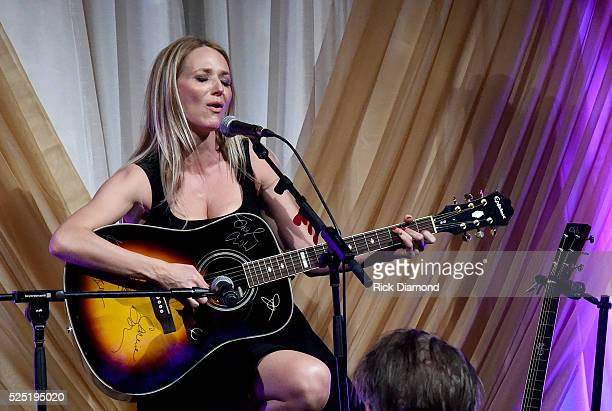 Singersongwriter Jewel performs with a guitar donated by cohosts Johnathon Arndt and Newman Arndt onstage during the 1st Annual Nashville Shines for...