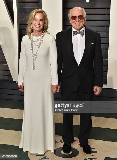 Singersongwriter Jimmy Buffett and Jane Slagsvol arrive at the 2016 Vanity Fair Oscar Party Hosted By Graydon Carter at Wallis Annenberg Center for...
