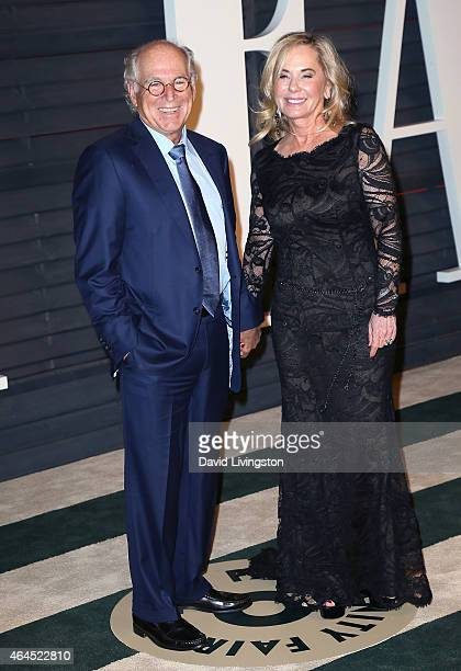 Singersongwriter Jimmy Buffett and Jane Slagsvol attend the 2015 Vanity Fair Oscar Party hosted by Graydon Carter at the Wallis Annenberg Center for...